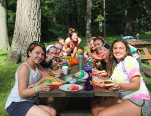 Campers enjoy cookouts and luaus as well as eating in the dining hall.
